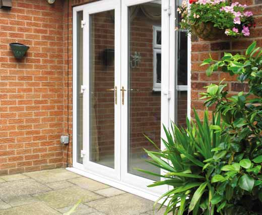 French doors with gold handles in white uPVC