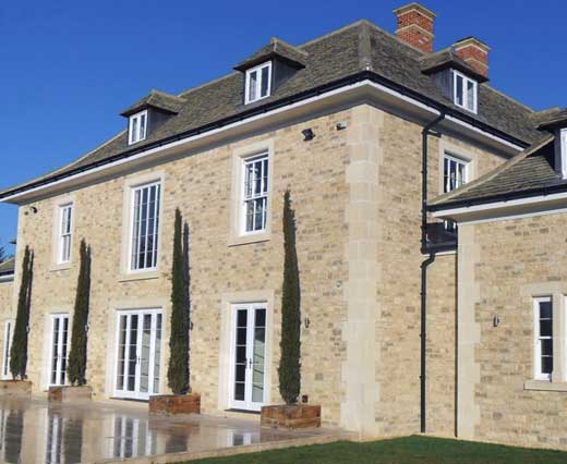 Traditional timber sliding sash windows on large property