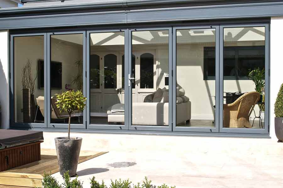 Bi-folding doors in grey aluminium