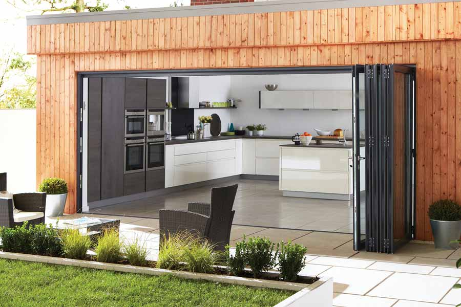 Black bi-folding doors in aluminium