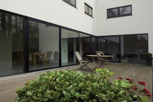 Black aluminium sliding patio door with large glass panels