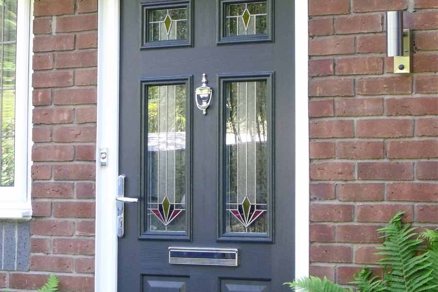 Front door with stained glass panels & Solidor Composite Doors in London | Keepout Windows
