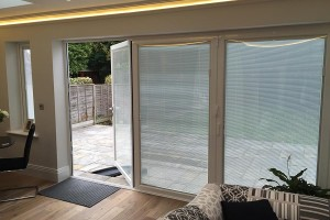Blinds fitted in between the glass panes of some bi-folding doors