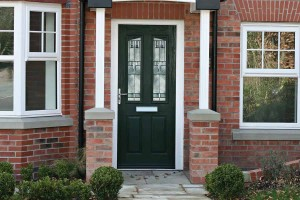 Green composite door with decorative glass