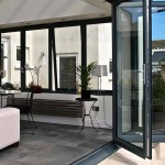 Grey aluminium bi-fold doors folded back to see some of the kitchen