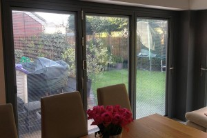 Bi-folding door installed and fitted with internal blinds