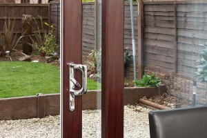 A close up of a mahogany coloured sliding patio door
