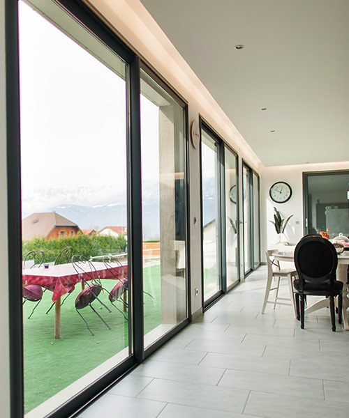 Sliding patio doors in greater london keepout windows for Sliding main door