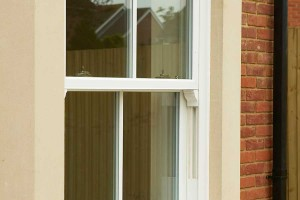 White upvc sliding sash window with mock horns