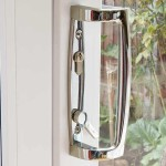 A close up of a sliding patio door handle in Chrome