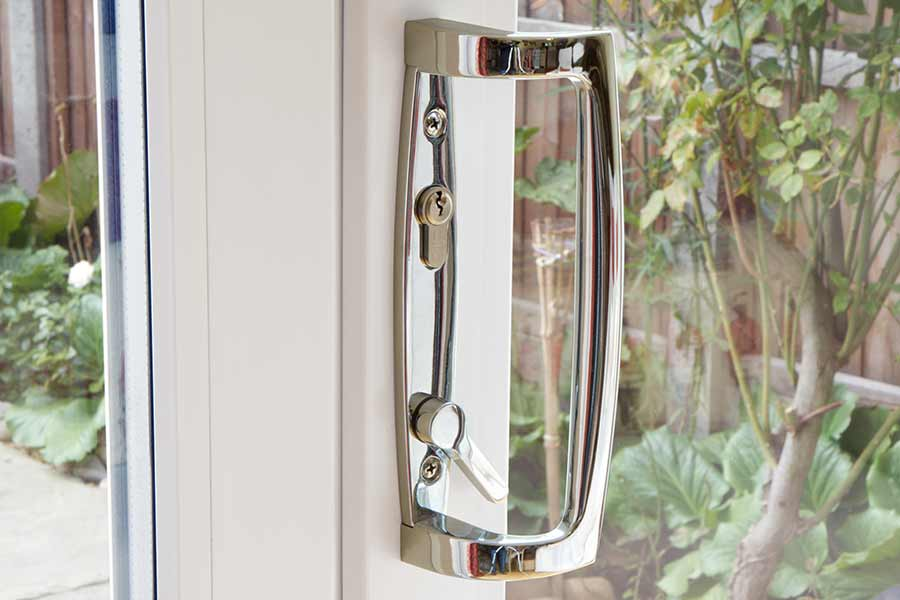 A close up of a sliding patio door handle in Chrome double glazing Tottenham