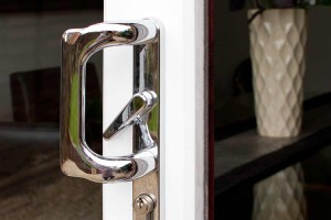 A close up to show the handle of a patio door