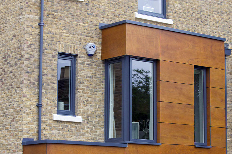Grey timber tilt and turn windows